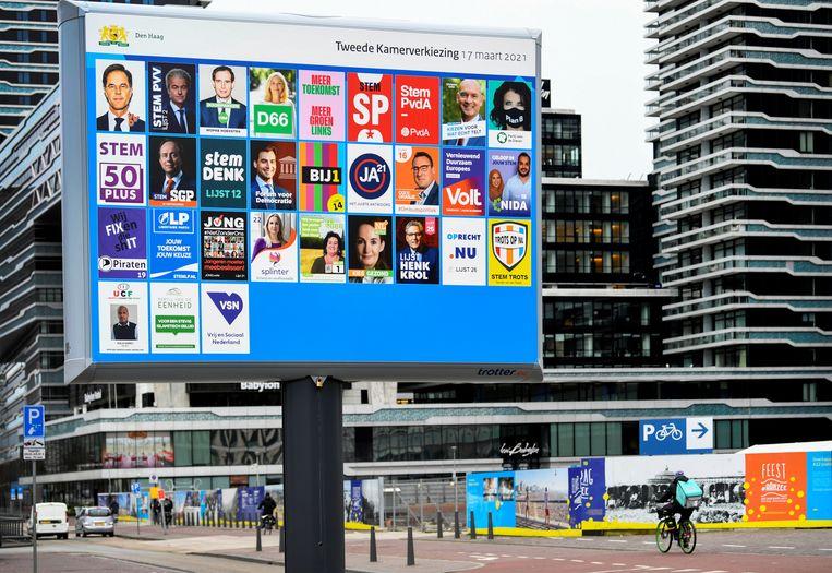 Een verkiezingsbord in Den Haag. Beeld REUTERS