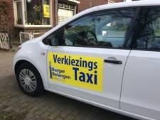 Met de taxi naar het stembureau of achterop de fiets bij de burgemeester in Hengelo