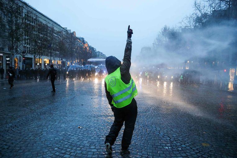 Een demonstrant in Parijs. Beeld AFP