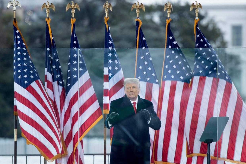 Trump spreekt zijn supporters toe tijdens een speech voor het Witte Huis in Washington. Beeld AFP