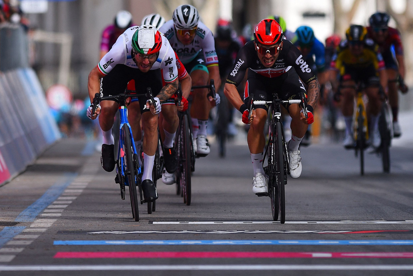Team Lotto-Soudal rider Australia's Caleb Ewan (R) sprints with Team Qhubeka Assos rider Italy's Giacomo Nizzolo to win the fifth stage of the Giro d'Italia 2021 cycling race, 177 km between Modena and Cattolica, Emilia-Romagna, on May 12, 2021. (Photo by Dario BELINGHERI / AFP)