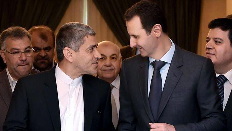 President Assad vandaag tijdens een ontmoeting met de Iraanse minister van Economische Zaken. Beeld ap