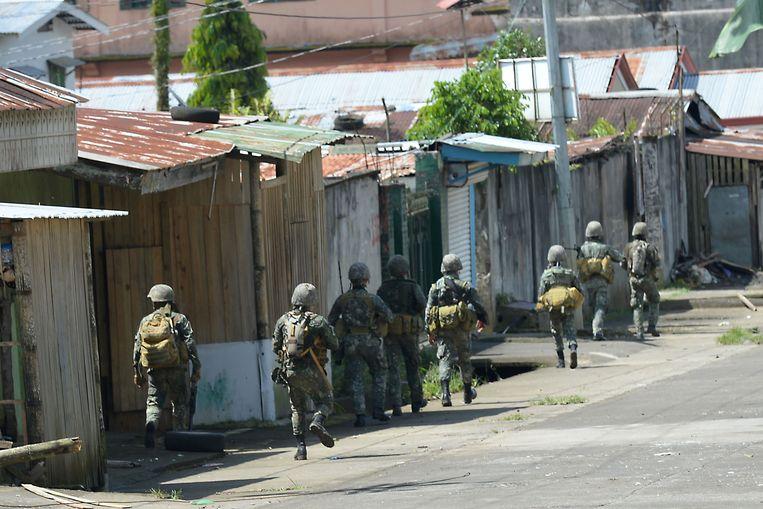 Filipijnse mariniers in Marawi.  Beeld AFP