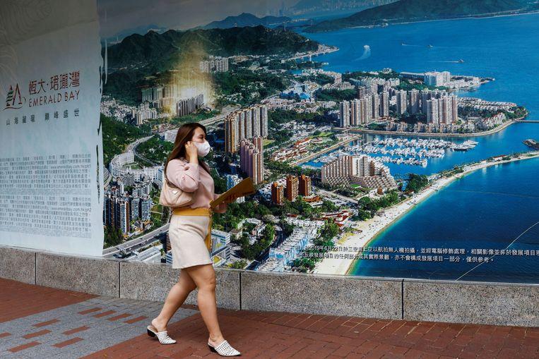 Een wervende afbeelding voor een van de projecten van Evergrande, Emerald Bay in Hongkong, Beeld REUTERS