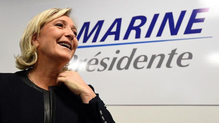 Voorzitter van Front National Marine le Pen bij de opening van haar campagnekantoor in Parijs. Beeld afp