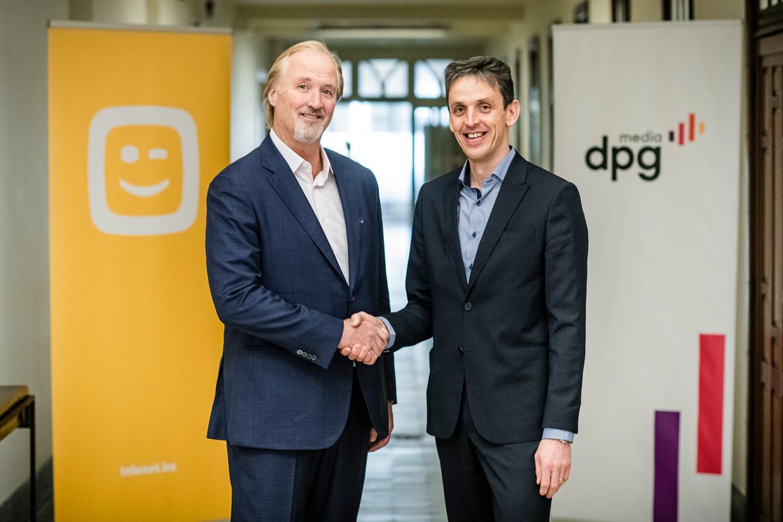 John Porter (CEO Telenet) en Kris Vervaet (CEO DPG Media België) slaan de handen in elkaar voor een Vlaamse streamingdienst. Beeld DPG Media