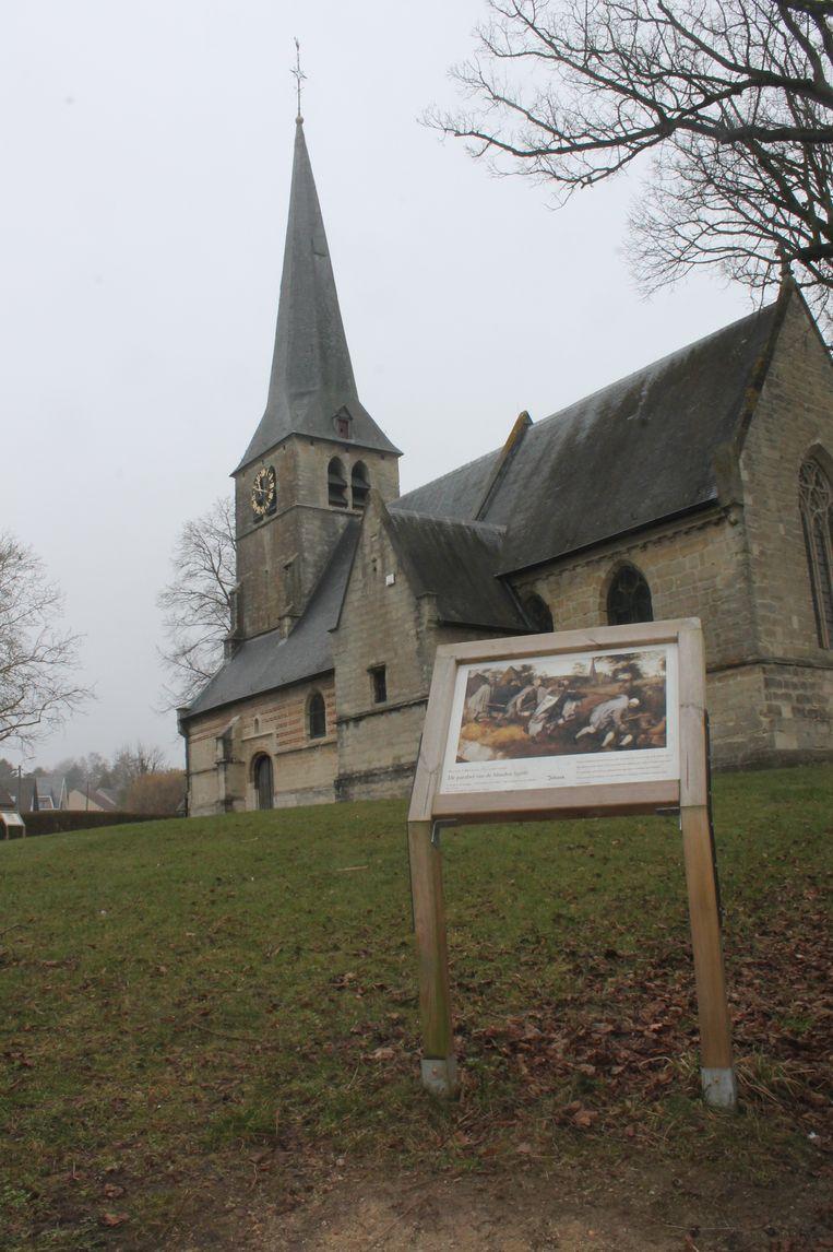 DILBEEK - Kerk Sint-Anna-Pede met op de voorgrond een reproductie van het Bruegel-schilderij 'De parabel der blinden'.