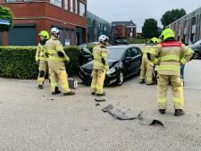 Automobiliste raakt gewond door botsing tussen twee auto's in Ede