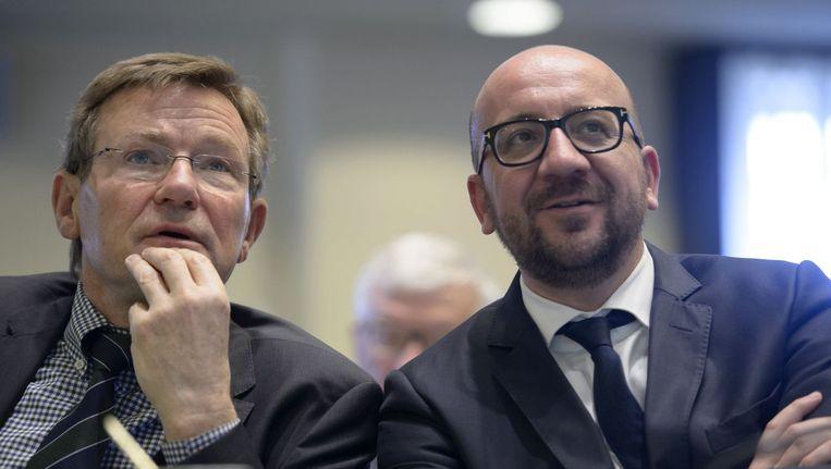 Minister van Financiën Johan Van Overtveldt (N-VA) en premier Charles Michel (MR). Beeld photo_news