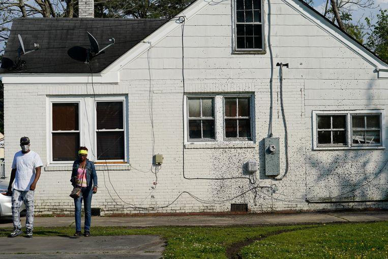 Het huis waar de politie een huiszoeking wilde doen. Beeld AP
