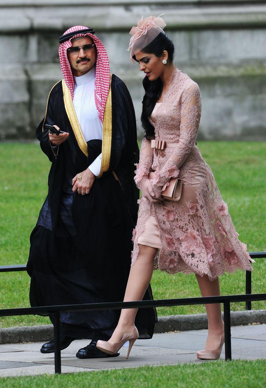 Al-Waleed met zijn voormalige echtgenote prinses Ameerah op de bruiloft van prins William en Kate Middleton in 2011. Beeld