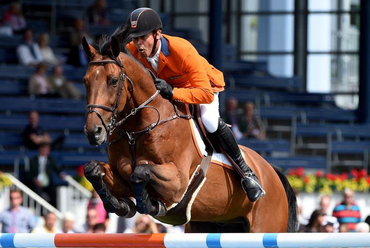 Jeroen Dubbeldam met zijn paard Zenith. Beeld afp