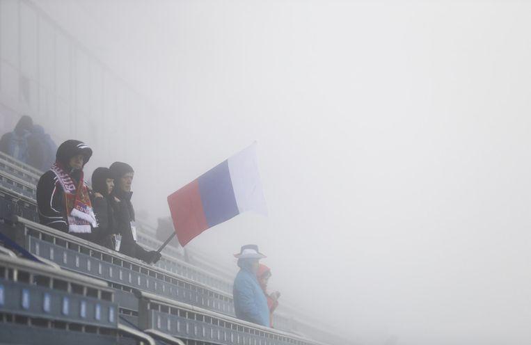 Mist in het biatlonstadion. Beeld ap