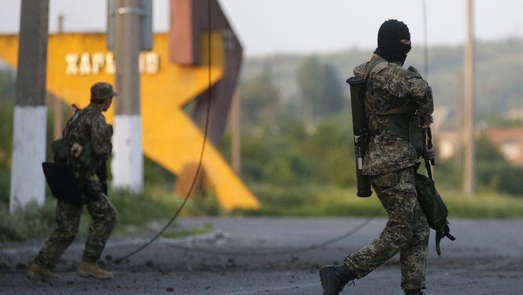 Pro-Russische militanten in de straten van Slavjansk Beeld ANP