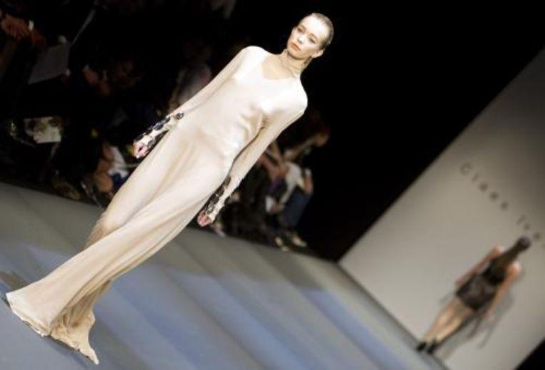Claes Iversen toonde zijn ontwerpen op de catwalk van de Amsterdam International Fashionweek. Thema van het evenement wsa Bondage. Foto ANP Beeld