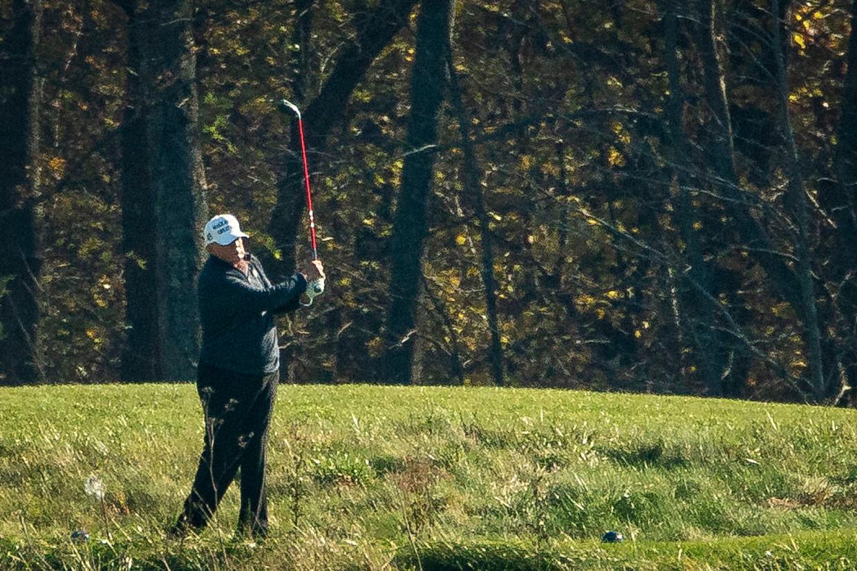 Donald Trump, een golfer met een serieuze handicap. Beeld Getty Images