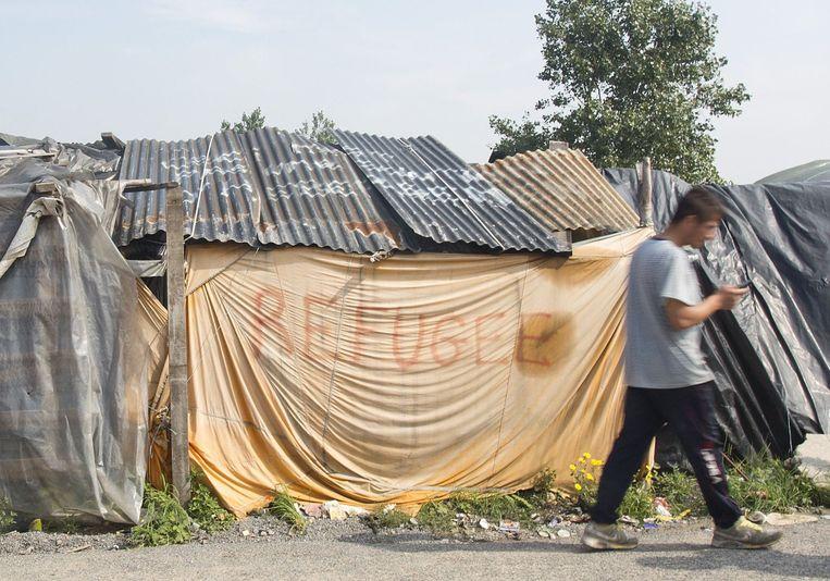 Een geïmproviseerde woning in de 'jungle' van Calais. Beeld PHOTO_NEWS