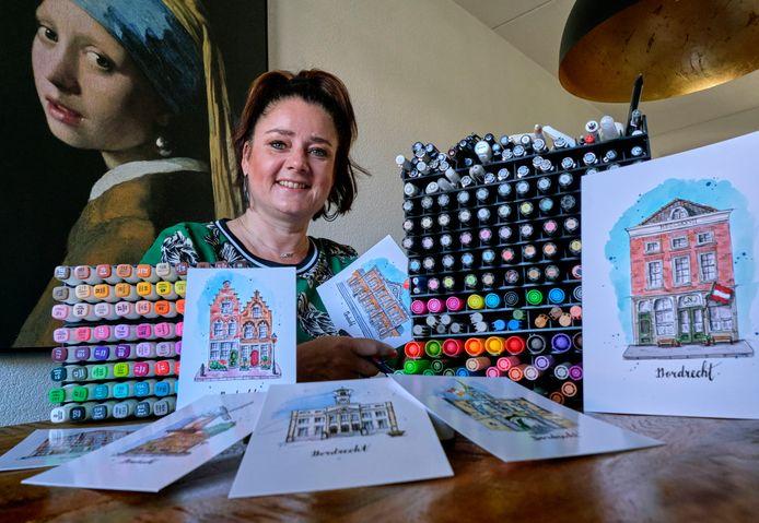 Petra Brouwer met haar tekenmateriaal en een aantal tekeningen van Dordtse panden.