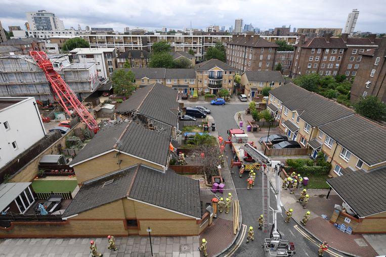 Schade in Bow, Londen, nadat een kraan op een aantal huizen viel. Beeld Getty Images