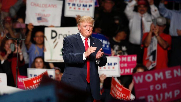 Donald Trump tijdens een campagnebijeenkomst in de staat Michigan. Beeld afp