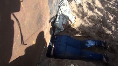 VIDEO. Mama en dochtertje (3) kruipen onder grensmuur in hoop op beter leven in de VS, maar worden snel tegengehouden door politie
