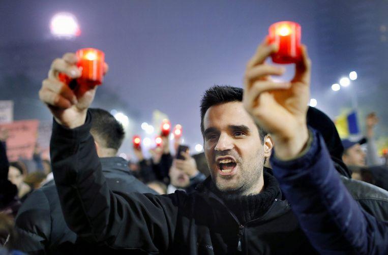 Een demonstratie in de straten van Boekarest Beeld epa