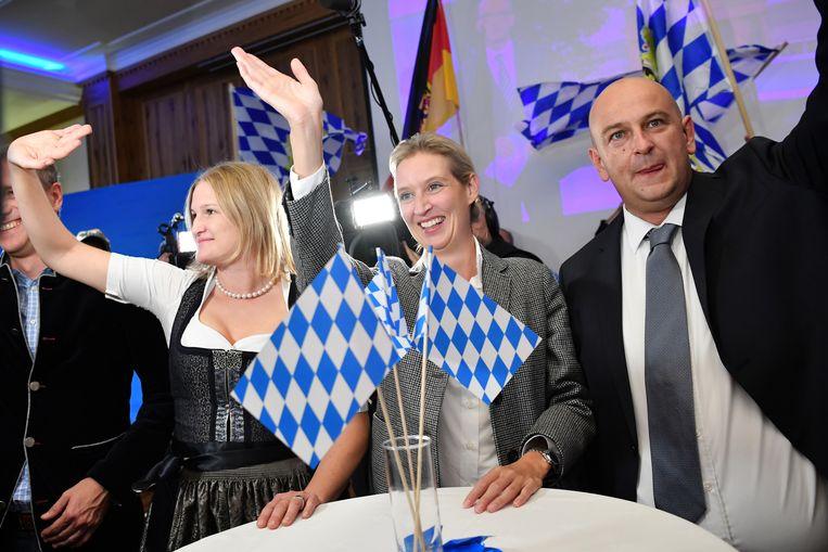 ...en bij de AfD, met in het midden vicevoorzitter Alice Weidel.  Beeld Getty Images