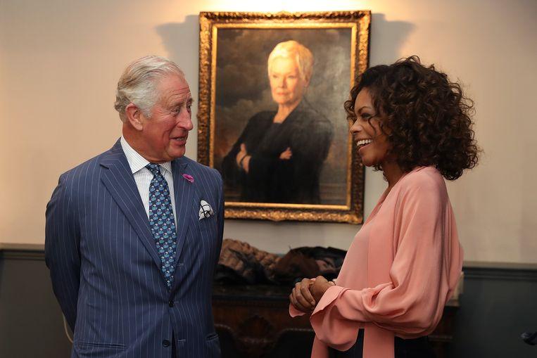 Charles ontmoet Naomi Harris.