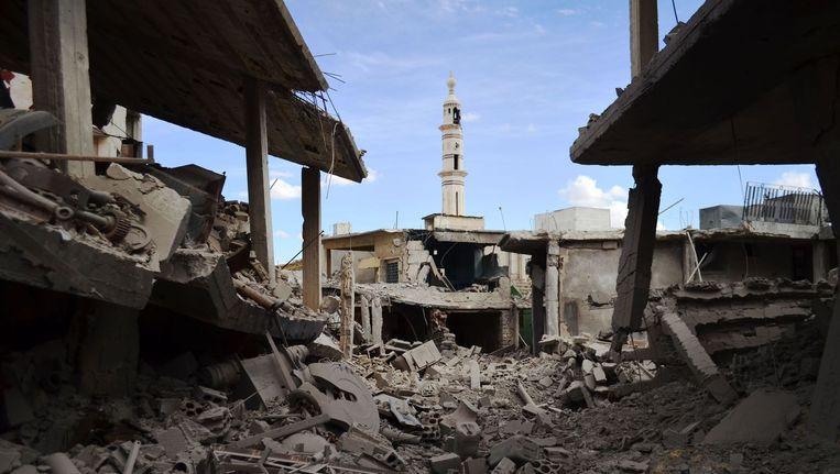 Beschadigde gebouwen in de provincie Homs. Beeld anp