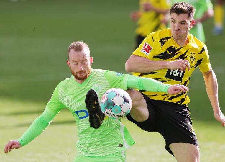 Thomas Meunier (r.) in actie voor zijn Duitse club Borussia Dortmund. Beeld Photo News