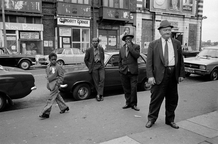 De woelige wijk Moss Side, waar de ondergrondse economie welig tierde, 1974. Beeld ©Martin Parr / Magnum Photos
