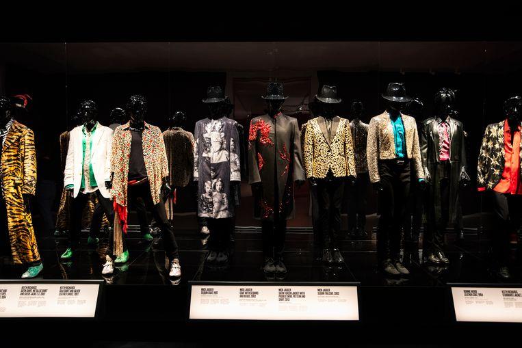 De pakken van Dior, Gucci en Prada schreeuwen je toe: de Rolling Stones waren stijliconen. Beeld David Vroom