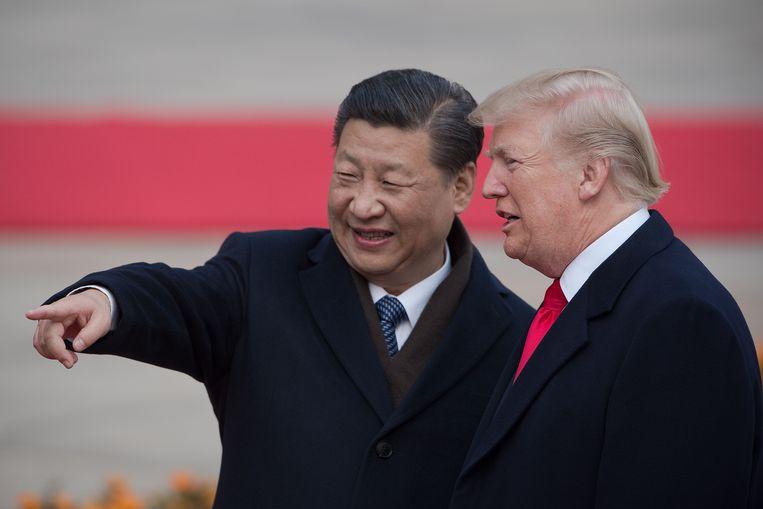 Xi Jinping en Donald Trump tijdens een ontmoeting in november 2017 Beeld AFP