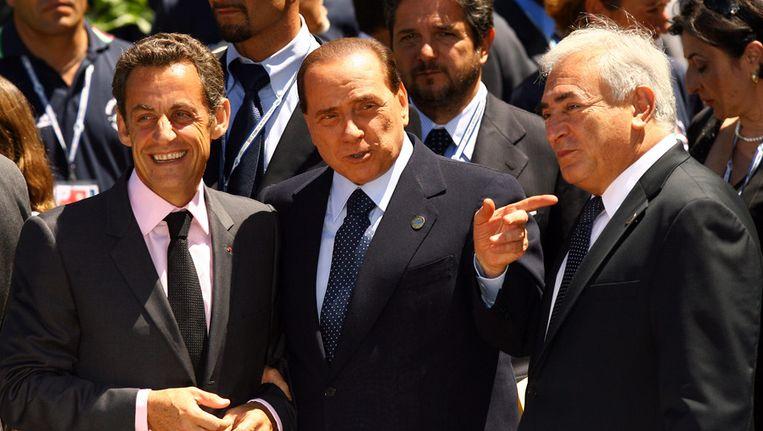 Silvio Berlusconi (m) met Sarkozy (l) en Dominique Strauss-Kahn in betere tijden. Beeld getty
