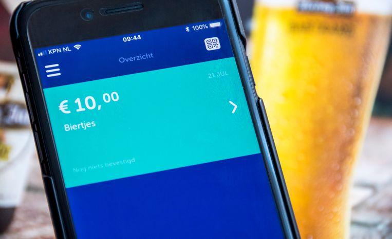 De betaalapp Tikkie op een mobiele telefoon. Met de app kunnen gebruikers betaaluitnodigingen naar elkaar versturen.  Beeld ANP XTRA