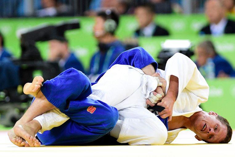 Kwartfinale: Van Tichelt neemt de maat van de Rus Denis Jartsev Beeld Photo News