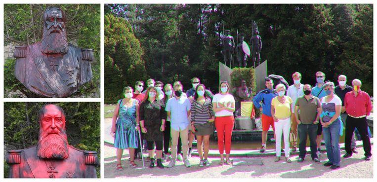 De groep maakte het met rode verf bekladde beeld schoon en plaatste een Belgische vlag.