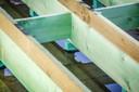 Het hele dak is voorzien van een constructie op rubbers om de akoestiek optimaal te houden.