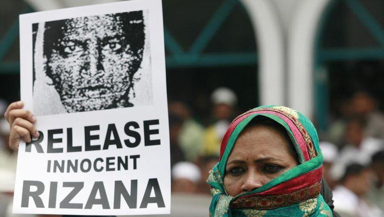 Een Srilankaanse vrouw demonstreert tegen de executie van Rizana Nafeek. Beeld reuters
