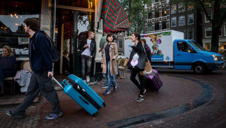 Toeristen in De Jordaan. Beeld Rink Hof