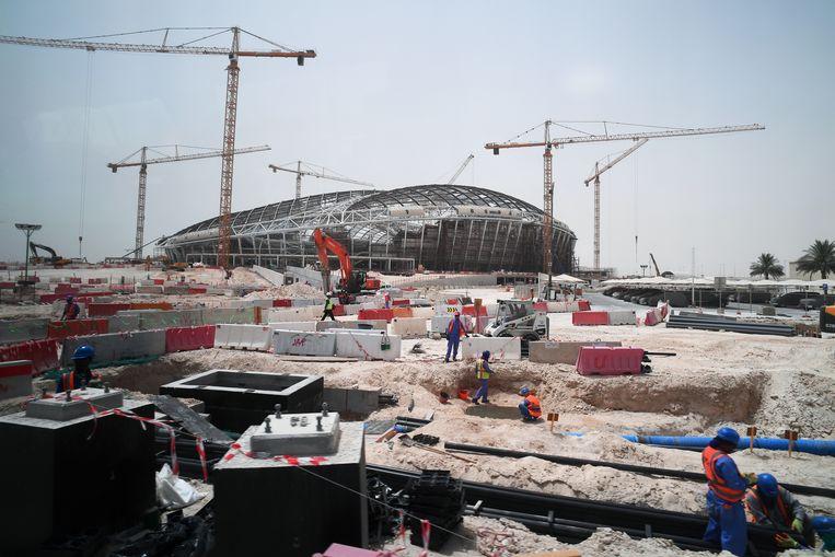 Werkzaamheden aan het Al-Wakrah stadion in Doha.  Beeld BELGAIMAGE
