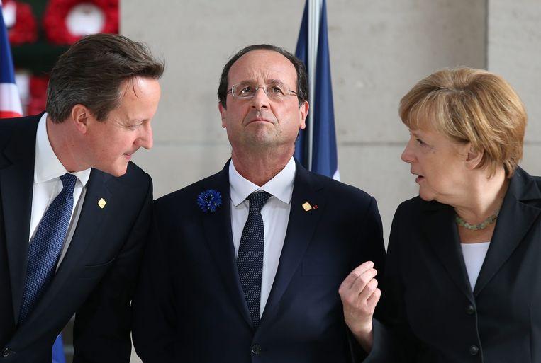 David Cameron, François Hollande en Angela Merkel. Beeld EPA
