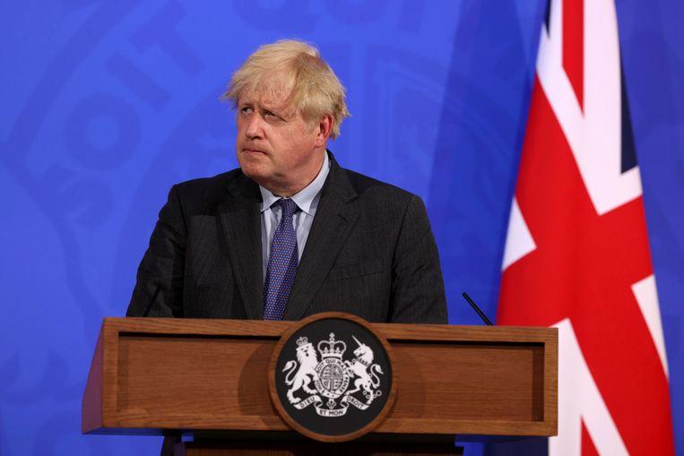 De Britse premier Boris Johnson kondigt het uitstel aan.  Beeld AP