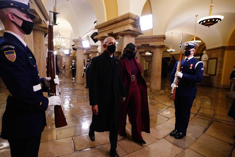 Voormalig president Barack Obama en zijn vrouw Michelle Obama waren aanwezig bij de inauguratie. Donald Trump woonde de ceremonie niet bij. Beeld AFP