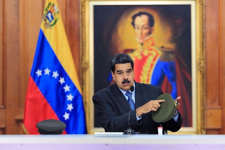 Venezolaanse president Nicolás Maduro tijdens zijn televisietoespraak dinsdag. Beeld EPA