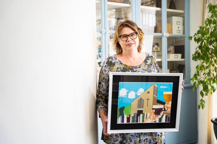 """Kunstenaar Petra van Houdt uit Arnhem maakt passieportretten. ,,Wanneer je het Vitesse-logo aan een flat hangt, blijkt de buurman voor Ajax en de bovenbuurman voor Feyenoord. Dan levert het strijd op in plaats van dat het verbindt."""""""