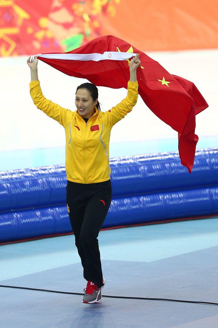Hong Zhang viert haar overwinning Beeld getty