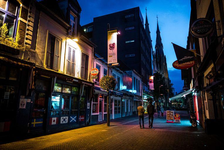 Lege cafés aan het Stratumseind in Eindhoven, de langste kroegstraat van Nederland. Beeld ANP