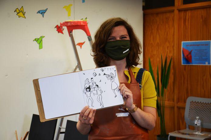Eline Godaert van Huize Vink fleurt de muren van de rustruimte van het vaccinatiecentrum van Ninove op met muurschilderingen. Van deze tekening maakt ze ook nog een schildering.