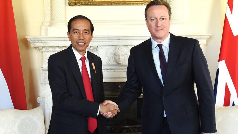 President Joko Widodo ontmoet deze maand verschilende Europese leiders, waaronder de Engelse premier David Cameron. Beeld EPA
